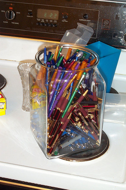 Many pens and pencils in a jar. Places to declutter
